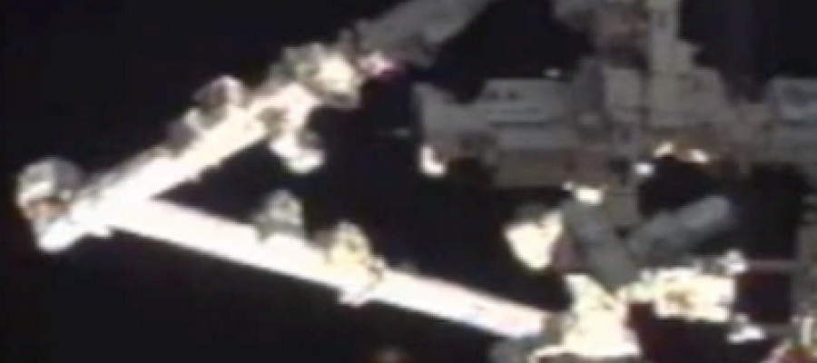 UFO hovers around the International Space Station