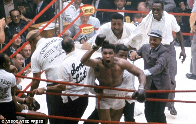 Celebration: When Liston quit after the seventh round Clay started jumping and waving his hands, yelling 'I'm the champ'
