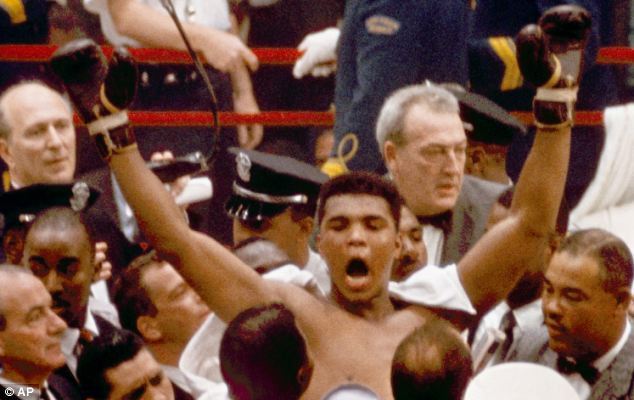 Familiar pose: Clay leaves the ring, arms raised, following his defeat of Liston in Miami