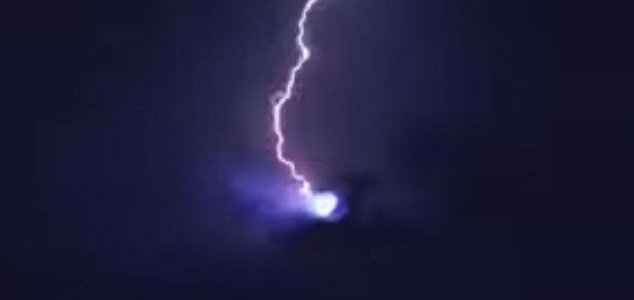 Lightning strikes UFO in New Year's Eve video